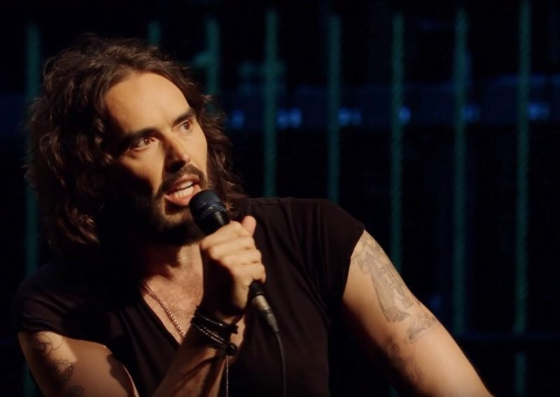 Russell Brand performs in his Netflix special Re:Birth