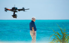 David Attenborough filming with a drone on reef top surrounding Heron Island (Photo: Atlantic Productions)
