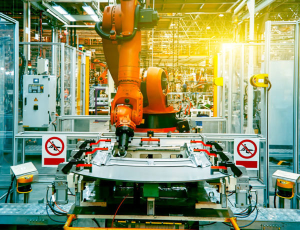 Robotic arm at work on a car chassis